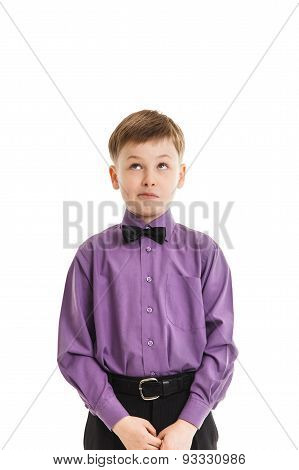 Young Boy With A Bow-tie Looking Up Thoughtfully