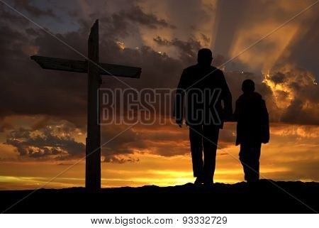 Back View Of Grandfather And Grandchild Walking Towards Sunrise