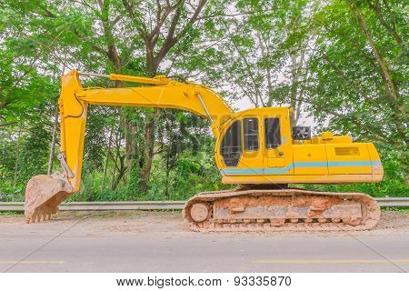 Single Backhoe On Road.
