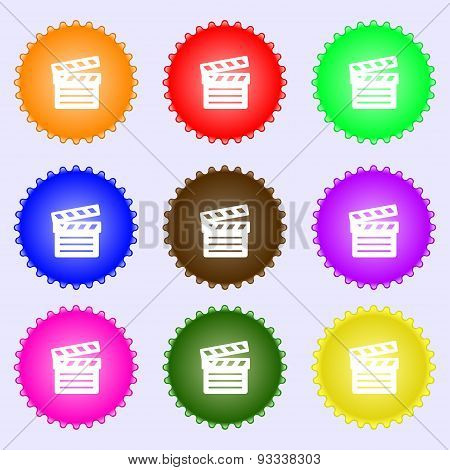 Cinema Clapper Icon Sign. A Set Of Nine Different Colored Labels. Vector