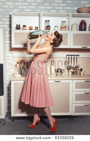 Girl Is Drinking From A Bottle Of Soda.