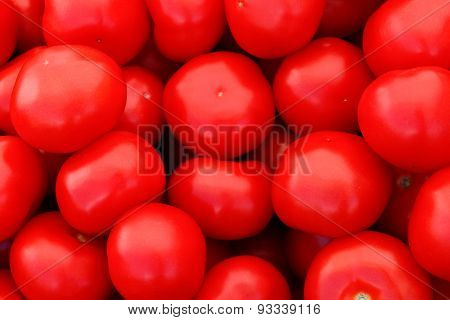 some fresh red tomatoes lie in one place