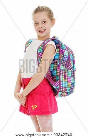 Happy joyful schoolgirl in red skirt and school satchel over his