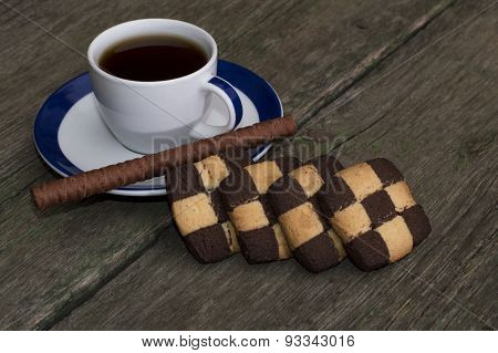 Cup Of Coffee And Cookies In A Row On An Old Table