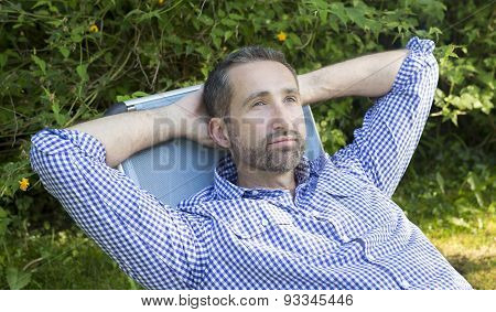 Man Sitting In A Garden