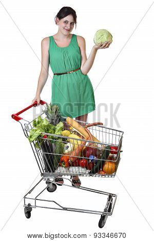 Shopping Trolley Filled Food, Young Woman Is Holding A Cabbage.