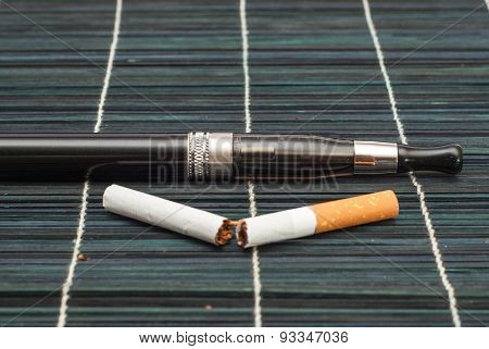 Electronic Cigarette And Liquid On Wooden Background