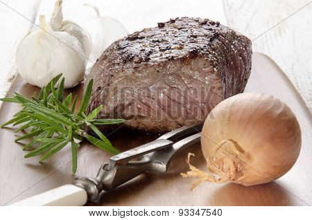 Roasted Beef Steak On A Wooden Board