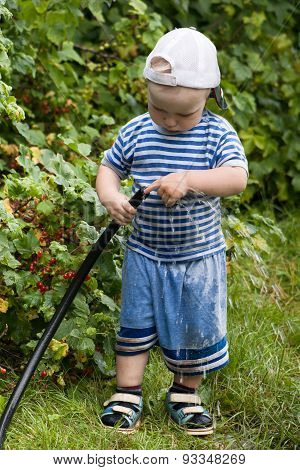 Child Plays With A Garden Hose