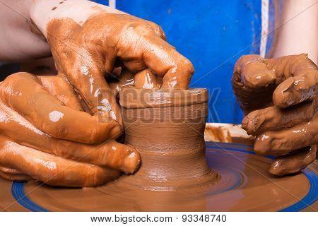 Closeup Of Hands Of Potter Teaching How Make Clay Pot