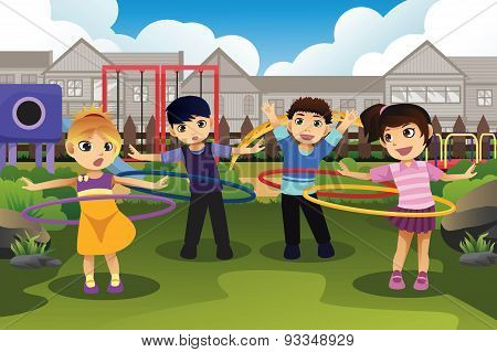 Children Playing Hula Hoop In The Park