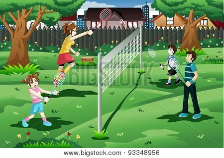 Family Playing Badminton In The Backyard
