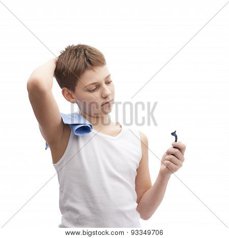 Young boy in a sleeveless shirt