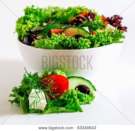 Salad in white bowl