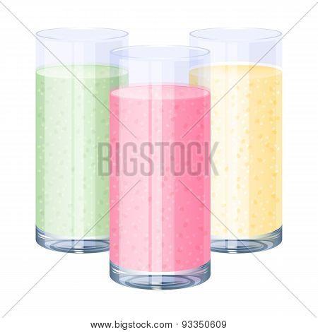 Colorful sweet fruit milkshakes set - pink, yellow, green.