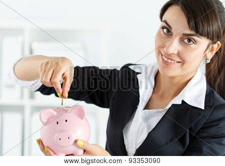 Piggybank And Woman