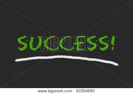 Success Green Script On A Blackboard