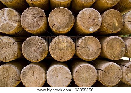 Wall of stacked wood logs showing natural discoloration