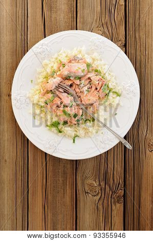Salmon With Rice, Scallion And Cilantro In White Plate On Wooden Background Copyspace