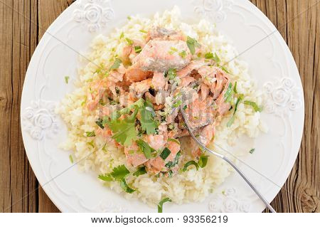 Salmon With Rice, Scallion And Cilantro In White Plate With Fork On Wooden Background