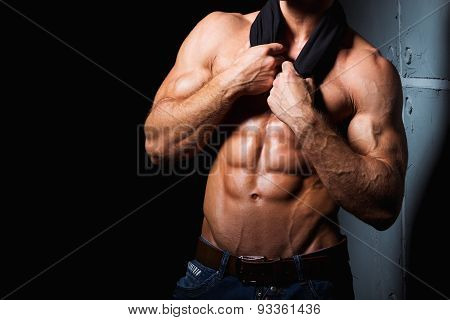 Muscular and sexy torso of young sporty man with perfect abs
