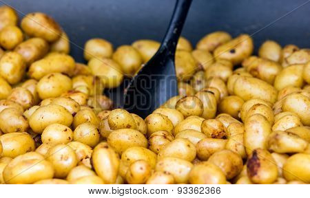 Whole Fried Young Potato Cooked In Big Metal Wok. Street Market
