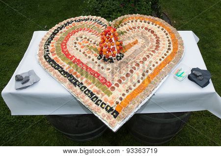 Assorted Savoury And Tasty  Snacks On A Plate Shaped In Heart