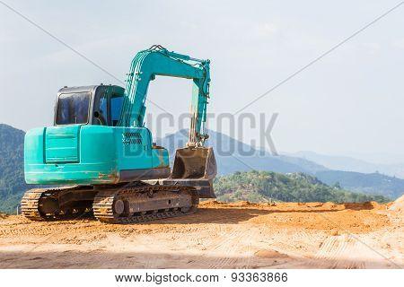 Green Backhoe Machine.