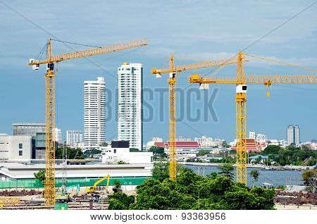 Construction Crane For High Building Project With The River View.