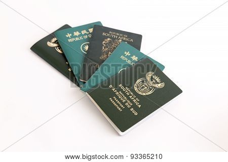 Muliple Passports On White Background