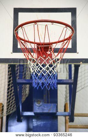 Basketball Hoop In A High School Gym