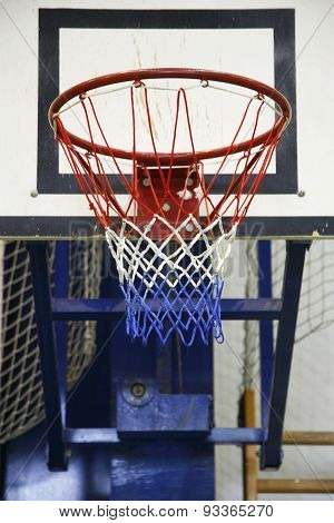 Basketball Hoop In A High School Gym
