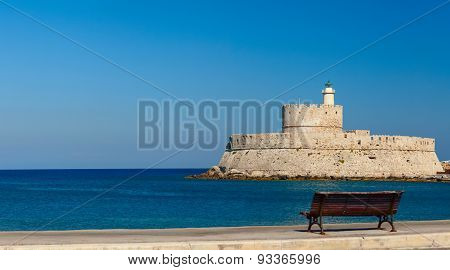City quay with an ancient fortress on the background. Rhodes Island, Greece.