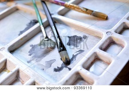 Three Paintbrushes On Palette
