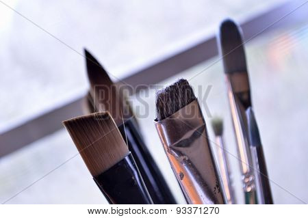 Closeup Of Paintbrushes In An Art Studio