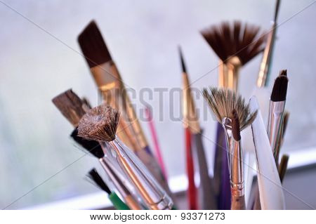 Closeup Of Colorful Paintbrushes In An Art Studio