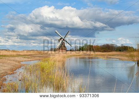 Dutch Windmill Over Blue Sky By River