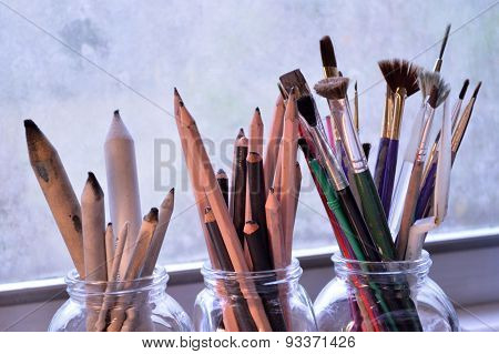 Three Jars With Fine Art Tools. Paintbrushes, Pencils And Tortillons.