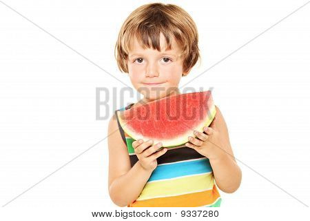 Young Boy Holding A Slice Of Watermelon