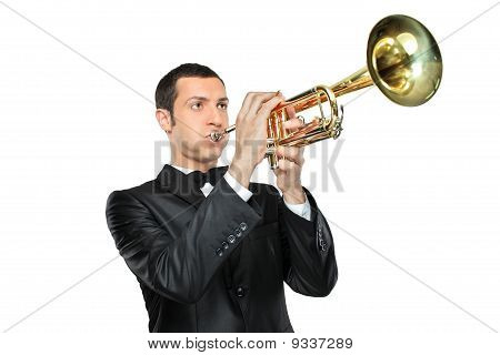 Young Man In Suit Playing A Trumpet
