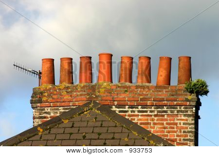 Old Brick Chimney Stack And Analogue Tv Aerial