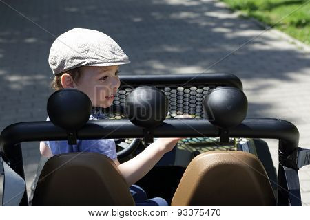 Child Driving A Jeep