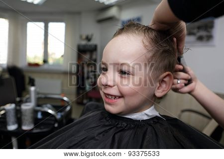 Laughing Child At Barbershop