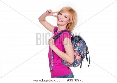 Happy student girl with backpack smiling and making cheerfull gesture. Isolated