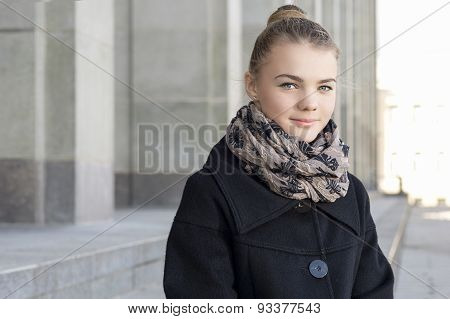 Youth Lifestyle Concept: Closeup Portrait Of Smiling Caucasian Teenage Blond Girl Outdoors.