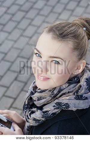 Youth Lifestyle Concept: Closeup Of Teenage Caucasian Girl Dealing With Cellphone Outdoor.