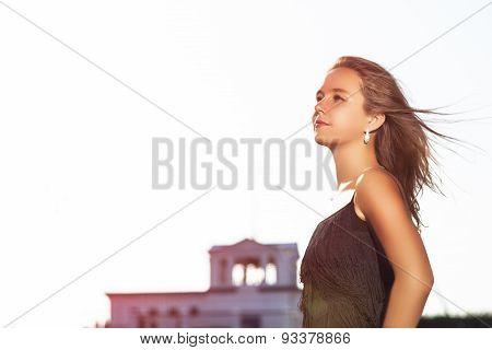 Fashon Caucasian Sensual Model Posing Outsoors Against Sky
