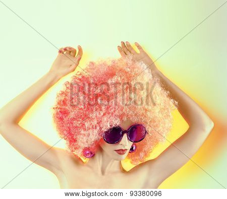 Portrait of Fashion girl with afro hairstyle, hands up