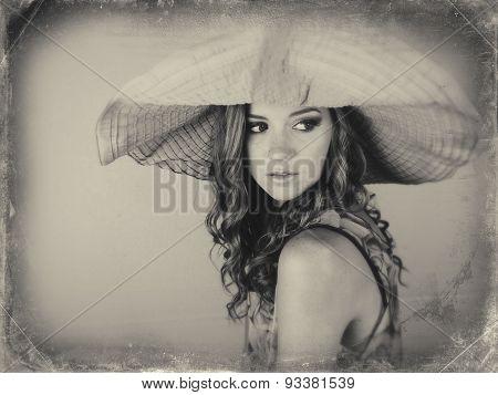 Woman wearing big hat