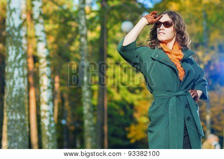 Fashion And Style Concept And Ideas: Good Looking Caucasian Female Model In Green Coat Posing